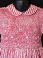 Robe smocks manches longues en coton piqué rayure fuchsia imprimée